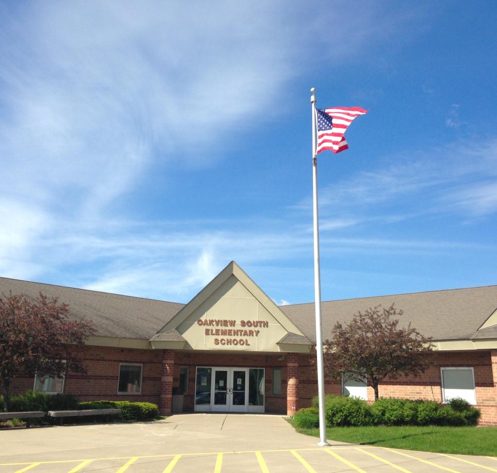 Oakview South Elementary School building with flag flying